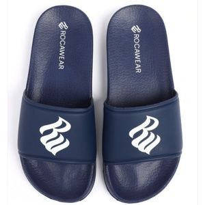 A brand new pair of Rocawear sandals